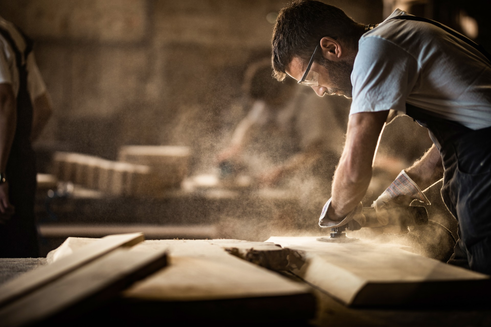 Image of carpenter sanding wood